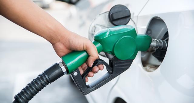 A car filling fossil fuel